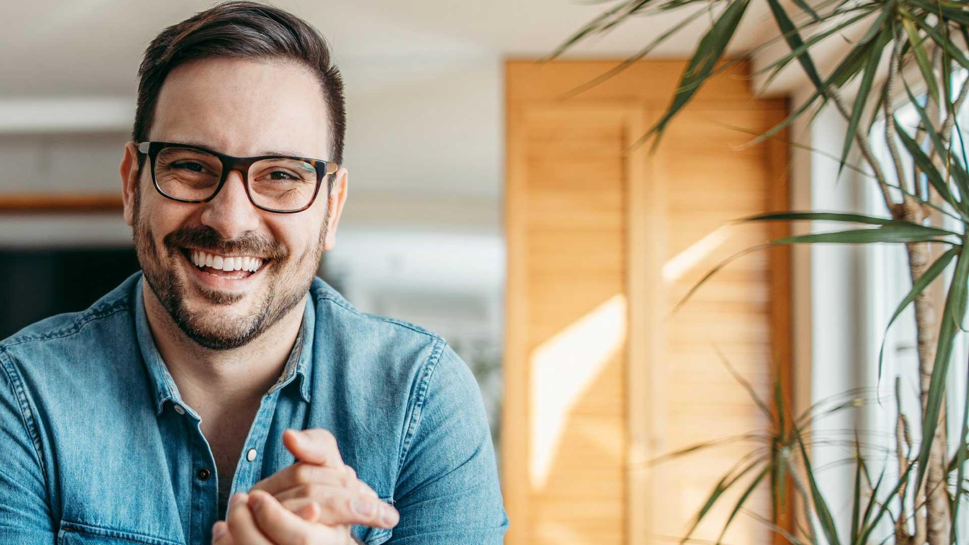 man_smiling_at_desk