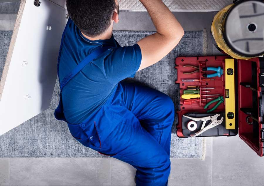 maintenance_worker_under_sink
