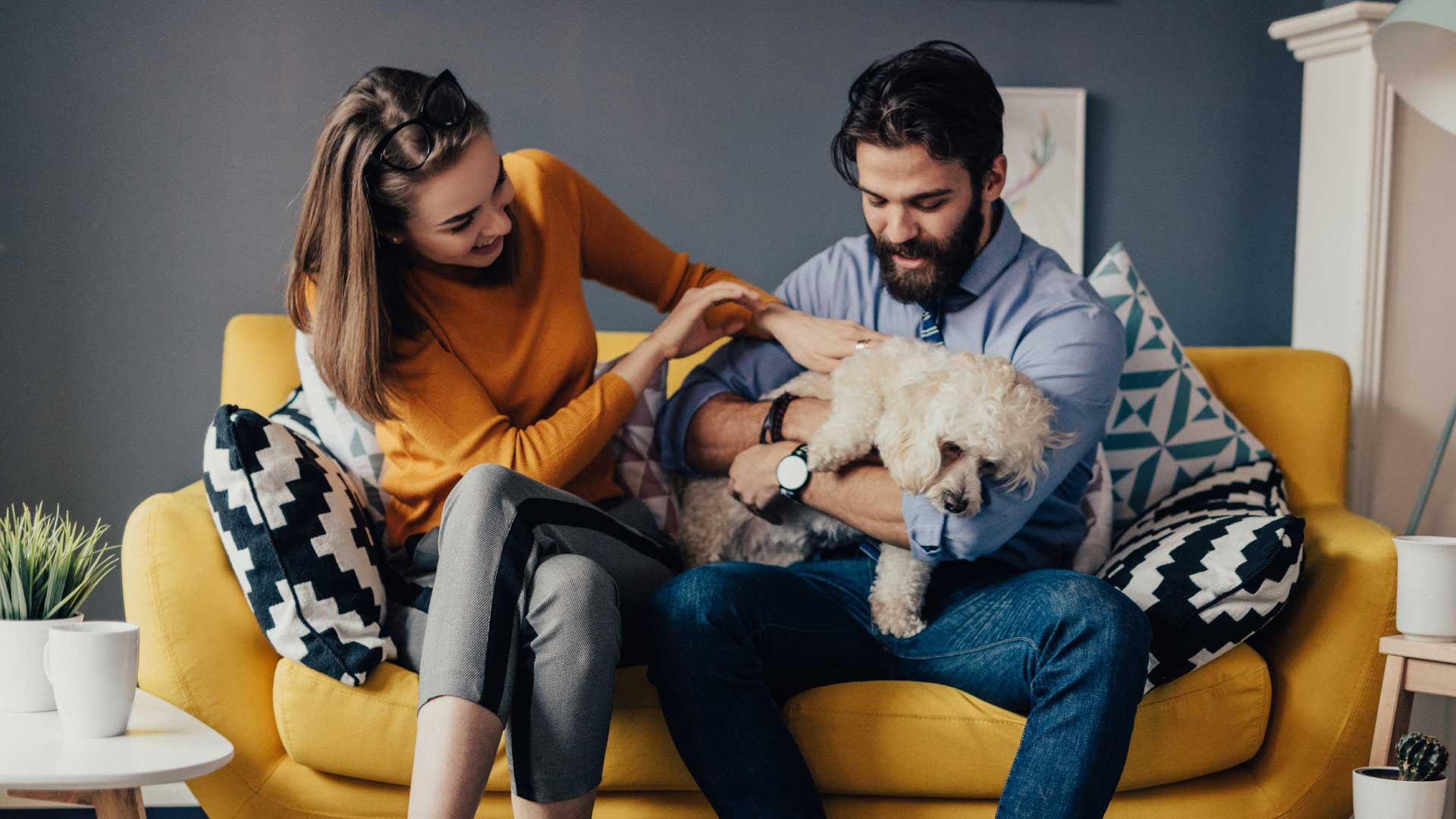 couple_on_couch_with_dog